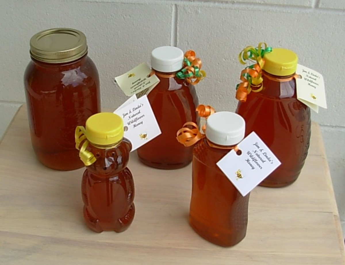 Jars of Jim and Linda's Natural Honey ready for sale.