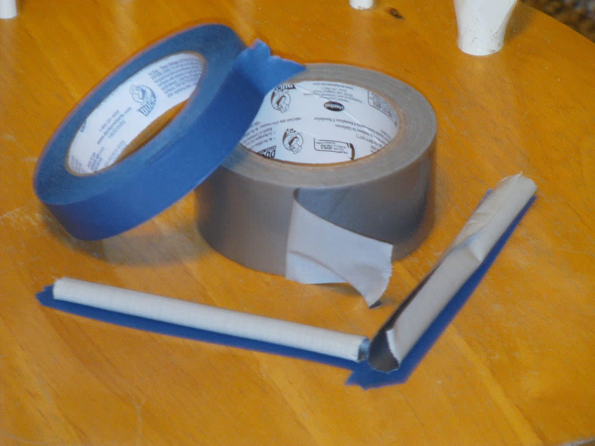 This is curled duct tape over masking tape. Put it around your bed, so that when the bugs come visiting, they get caught.