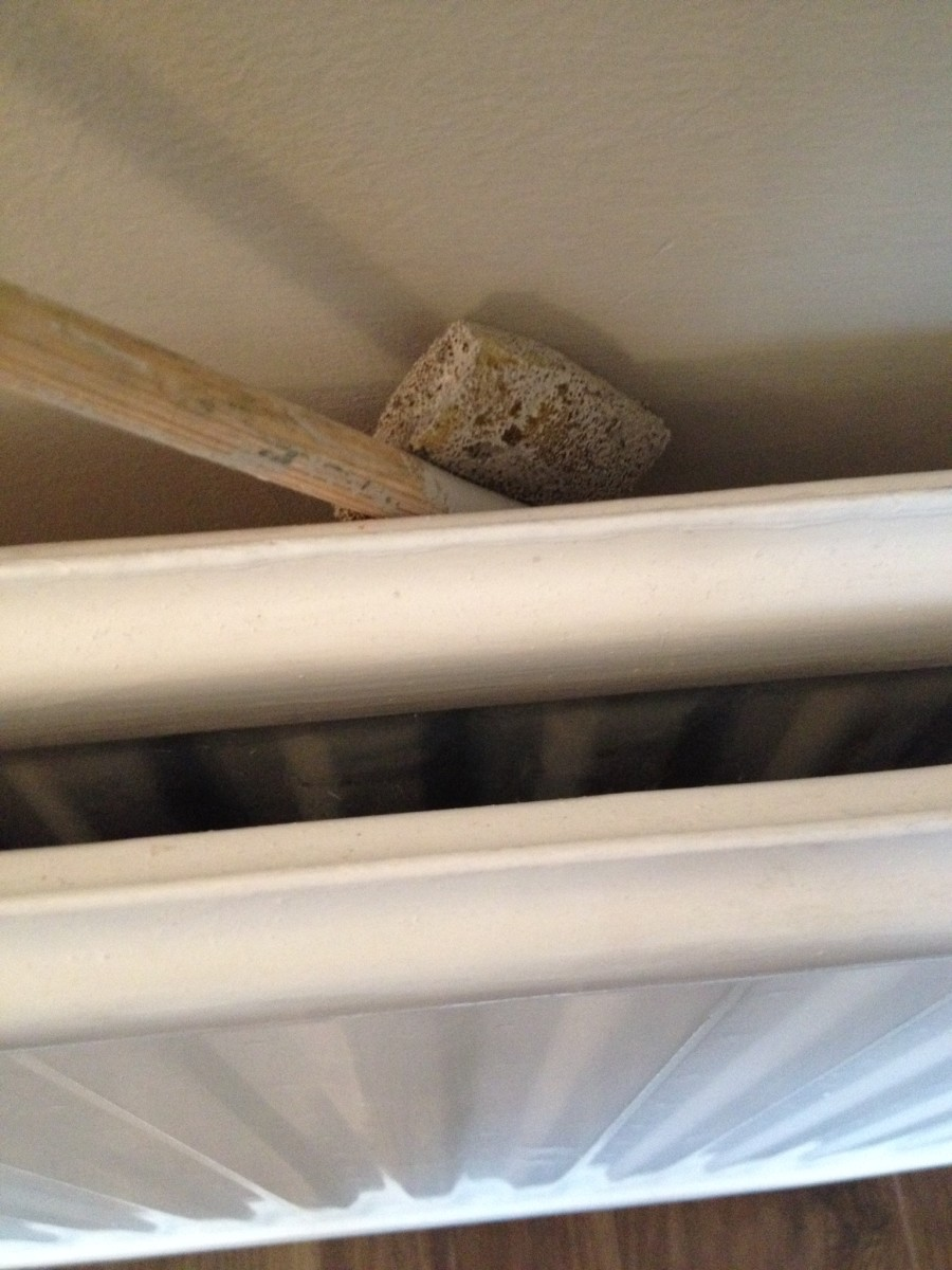 Use your new painting tool to get behind a radiator.