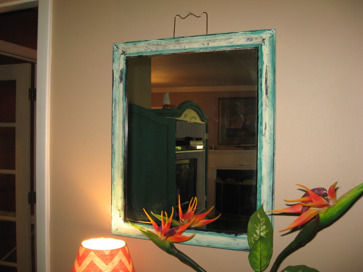 Mirrors really do help a small room look larger.