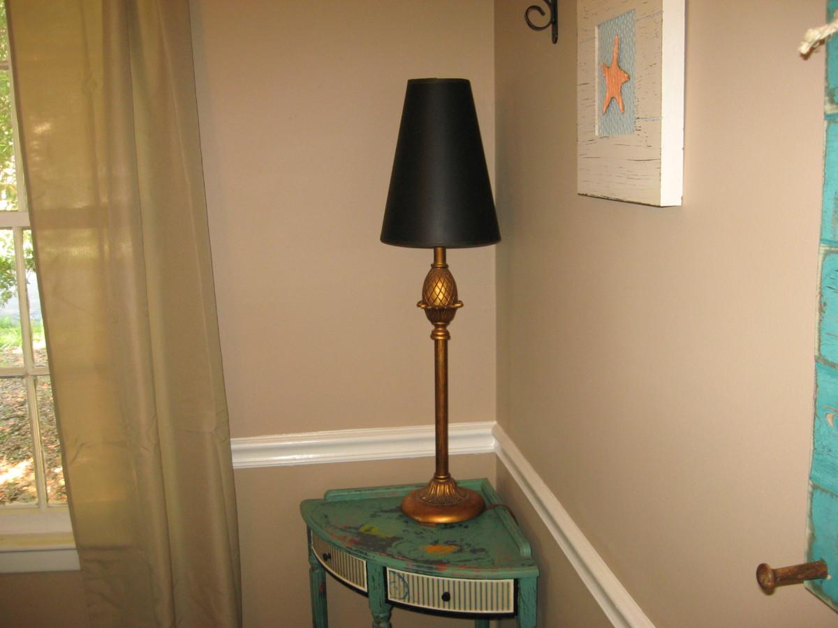 A tall, slim lamp helps to brighten up a dark corner.