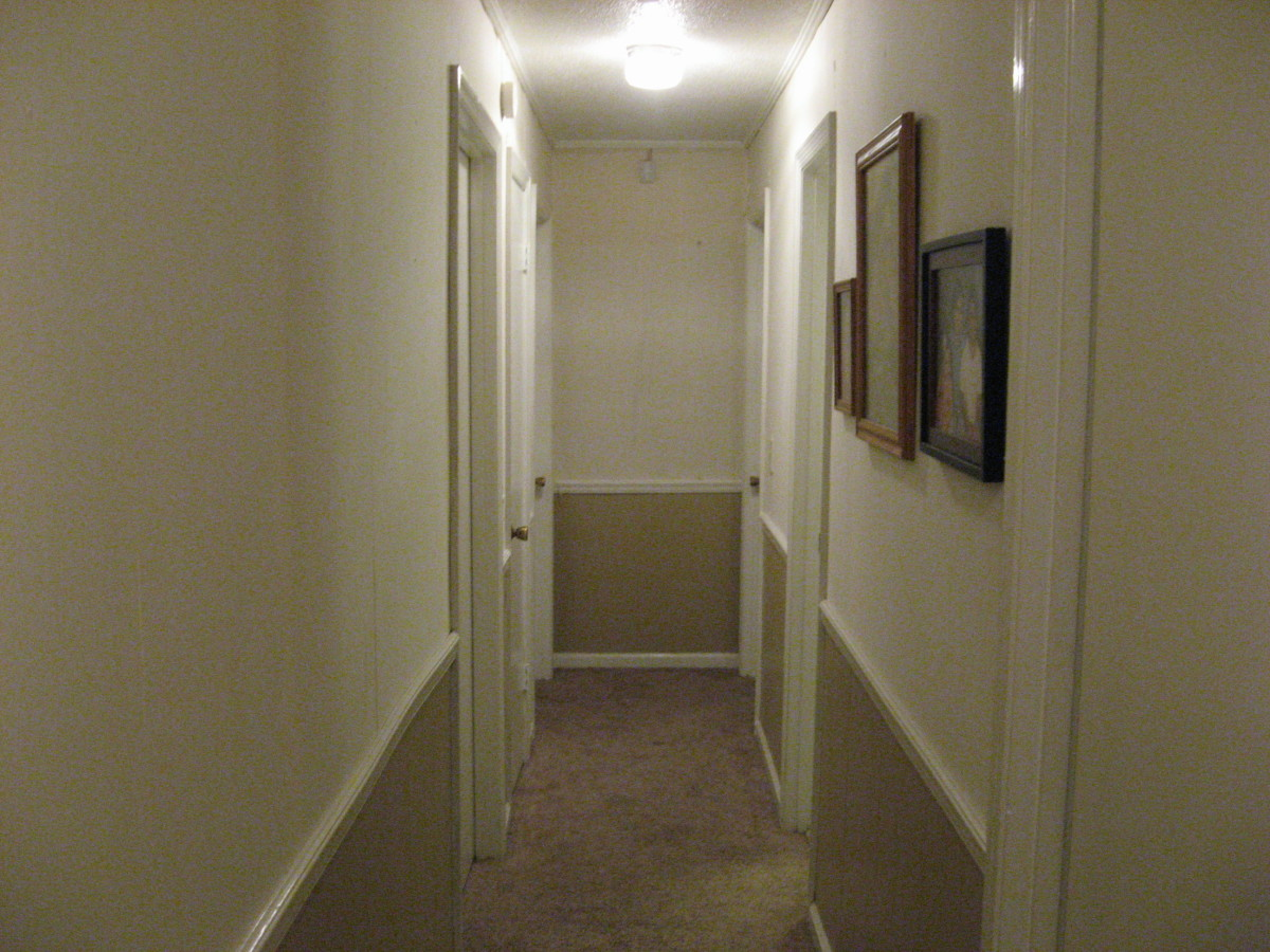 White walls make this narrow hall appear more open.