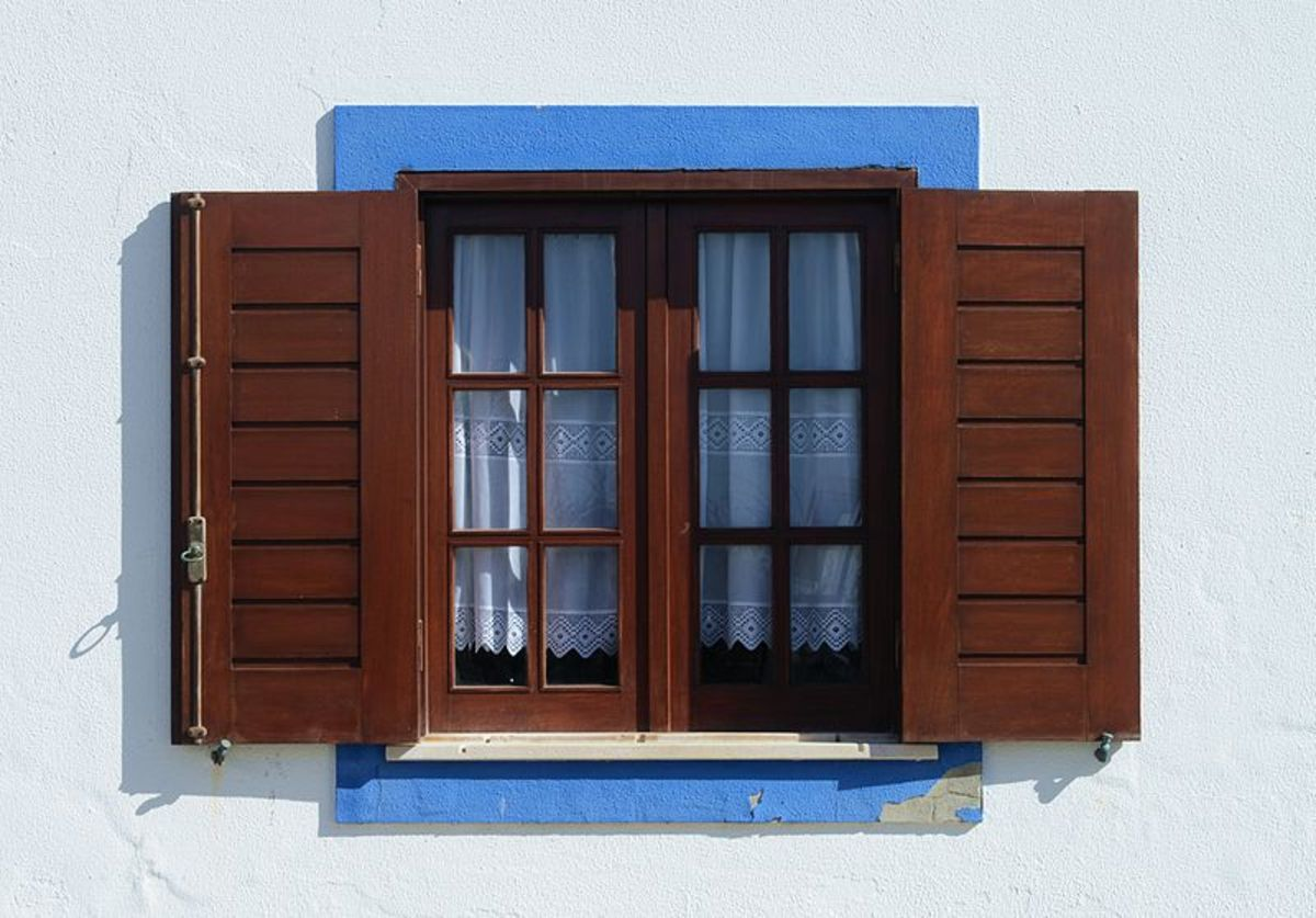 Window of traditional design in Porto Covo, Portugal