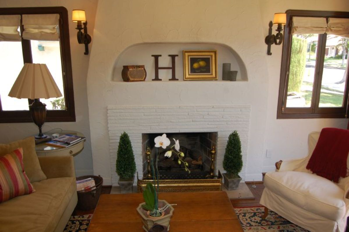 The living room layout showcases the focal fireplace and mantel.