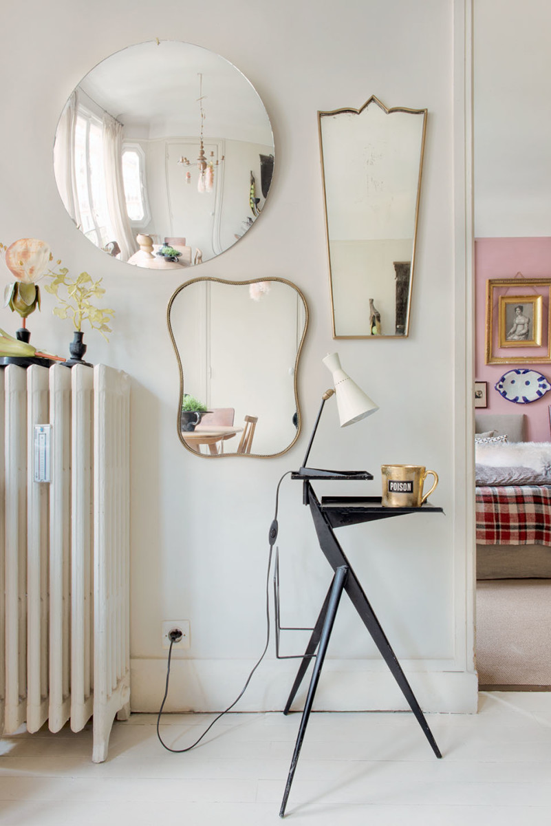 The mirrors reflect the whole space, making it appear larger, while bringing more natural light into the room.