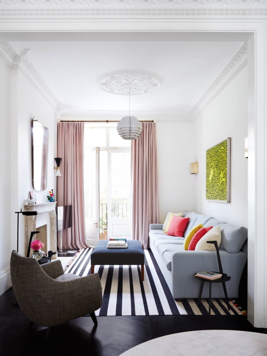 Placing the curtain rod right below the ceiling and hanging curtains that go all the way to the floor makes the ceilings appear higher.