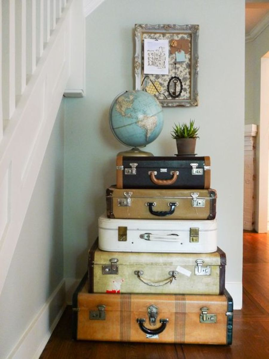 Placing the globe and plant on top of the suitcases pulls the display together. No one will ever know that you use the suitcases as storage.