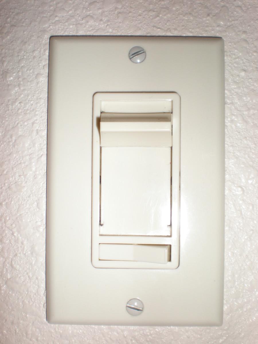 A slider-type dimmer switch.