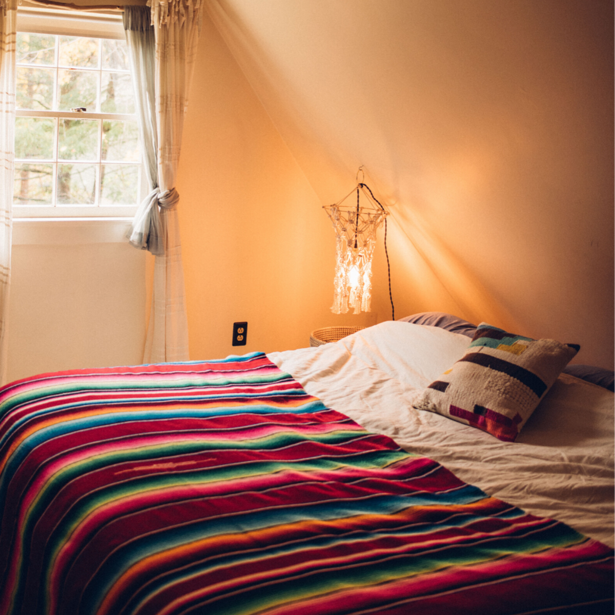 Bedside necessities: a light and an electric plug-in.