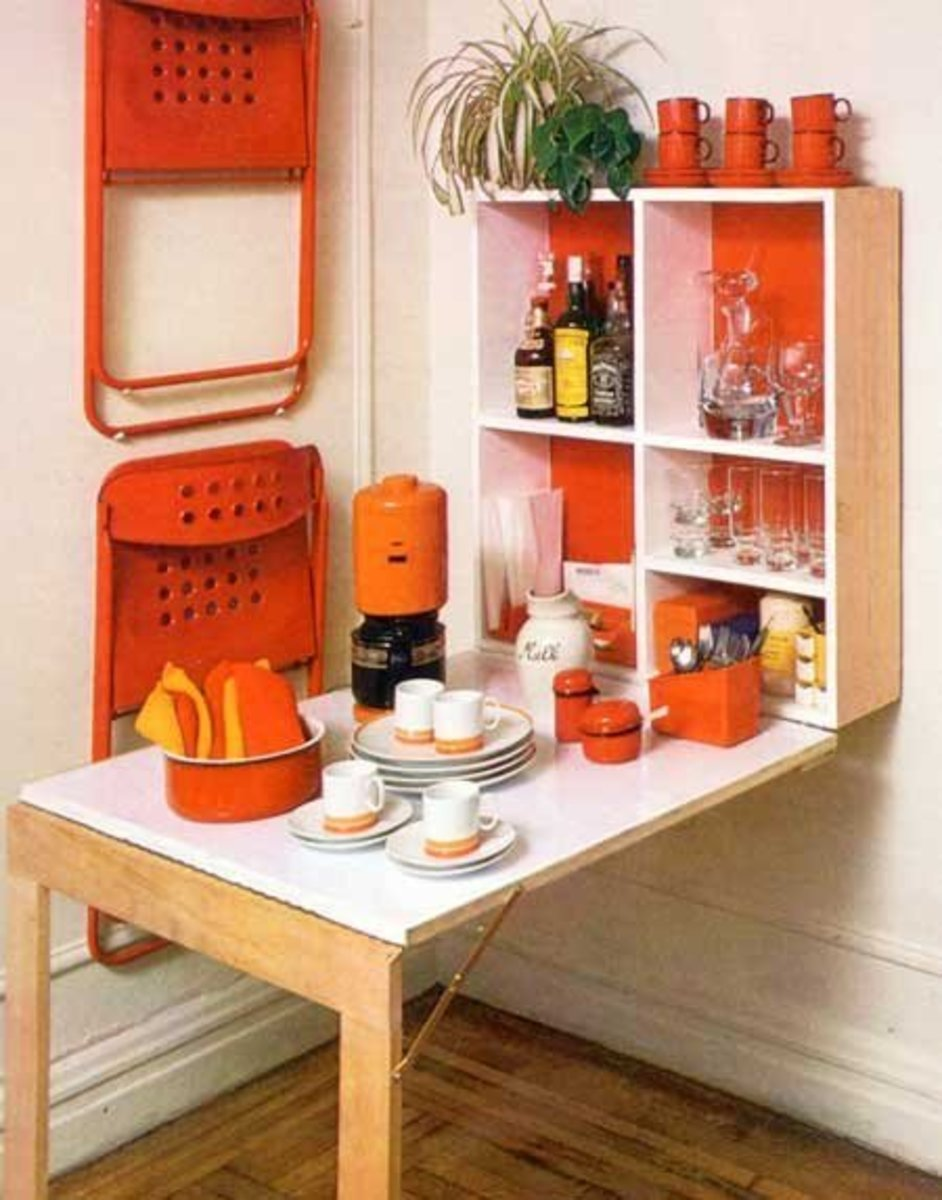 A folding kitchen table for two can help reduce clutter and open up a space - while the shelving is hidden when not in use.