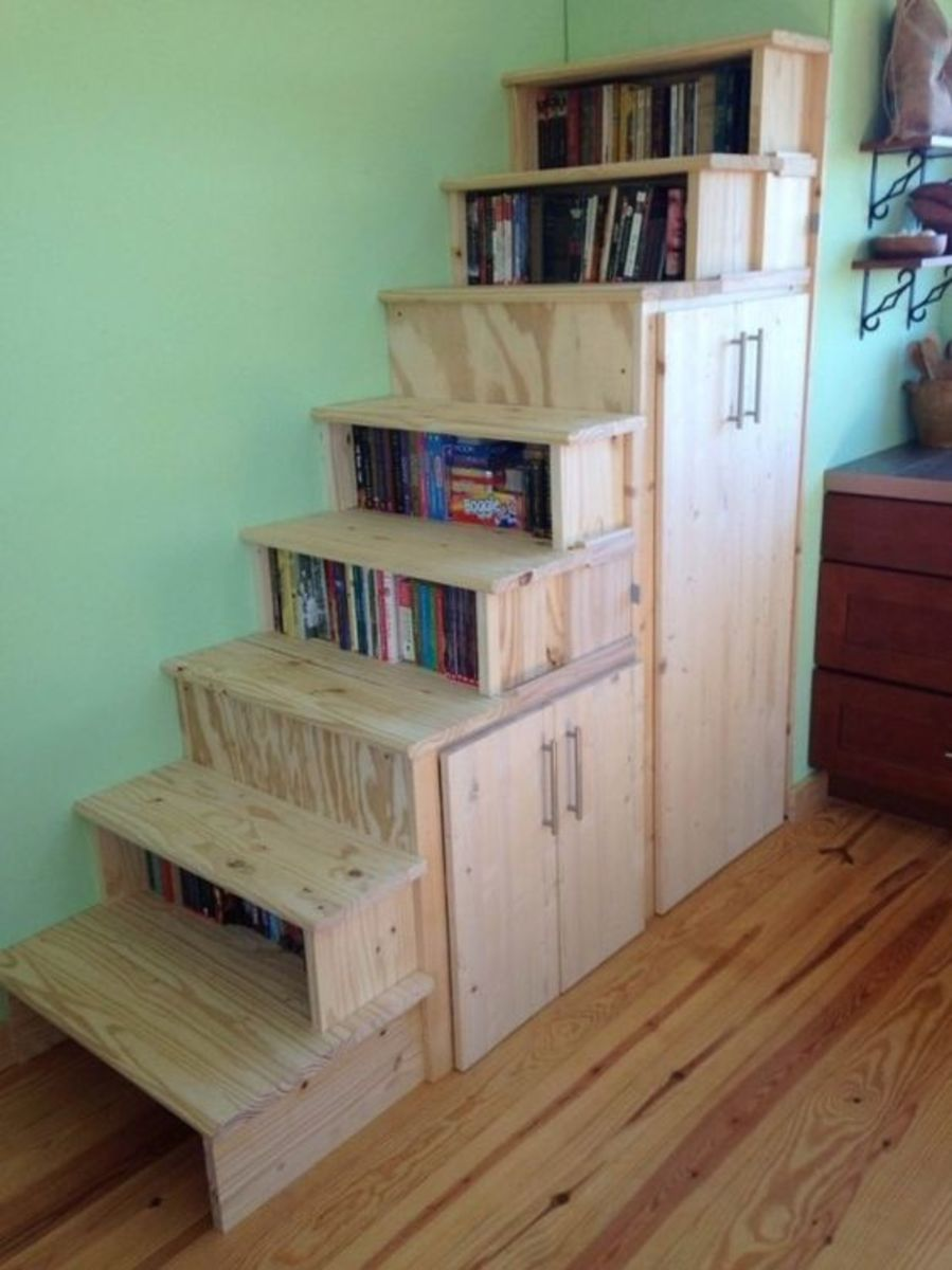 Storage under the stairs is a practical alternative for those who don't want to use a ladder to access the loft.