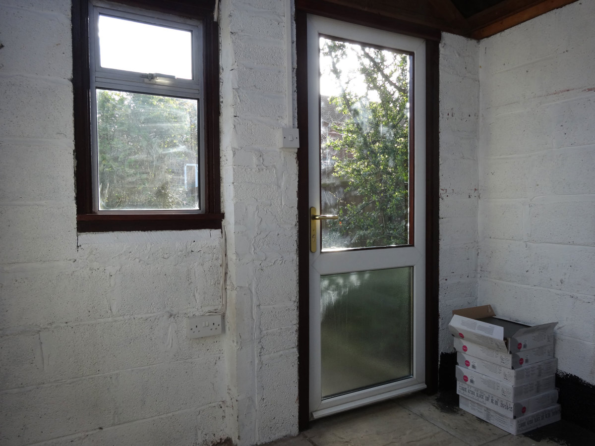 Recycled window and uPVC door fitted in shed