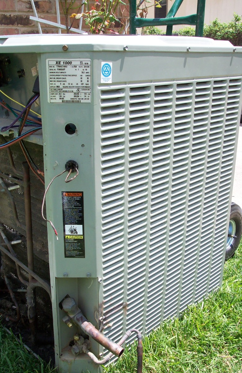 Cleaning the air intakes and coils of an air conditioner will boost its efficiency.