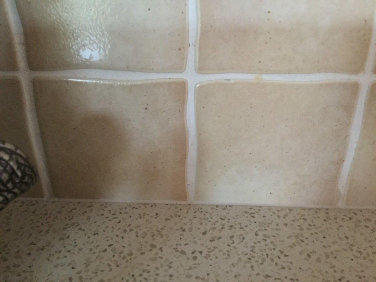 It wasn't necessary to remove any tiles. The overlay is only 7 mm thick and sealed to the tiles.