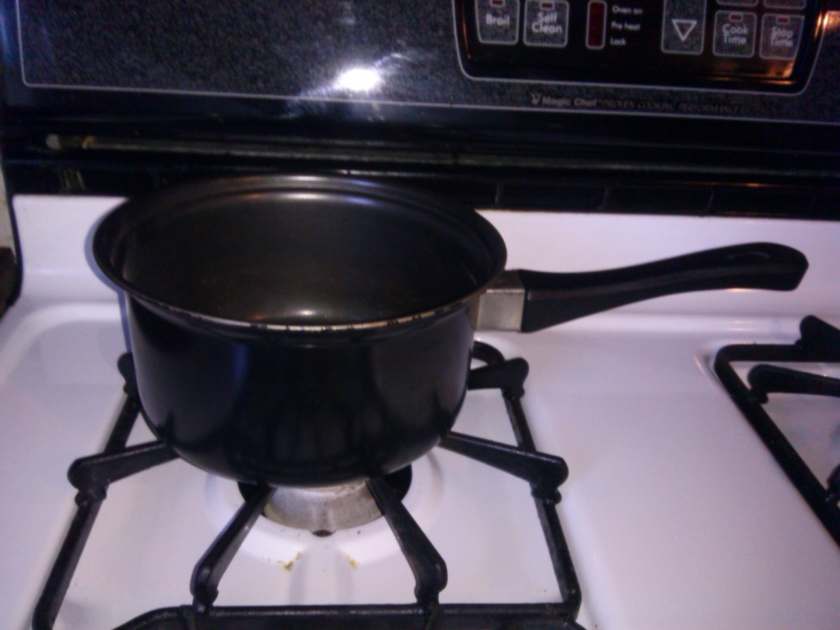 Place pot on stove and add water.