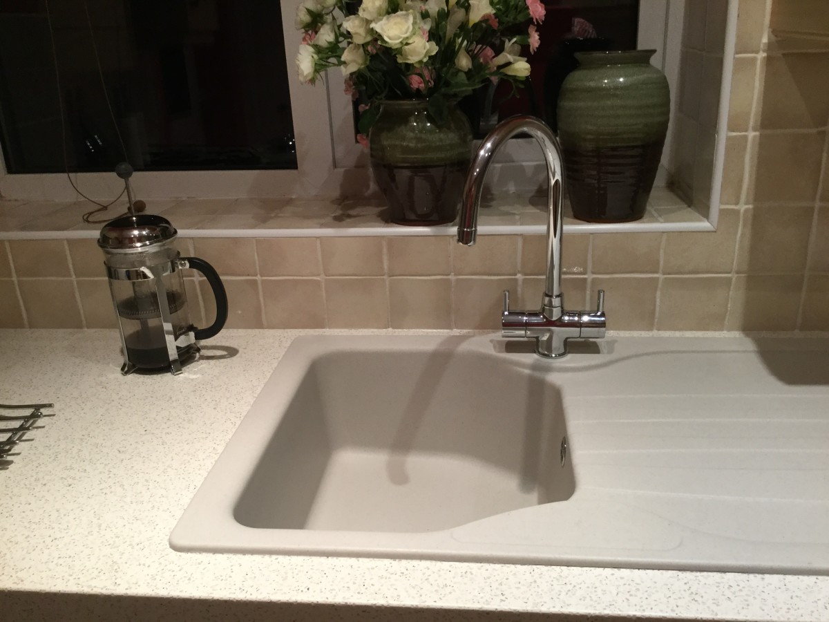 Franke sink, easily cleaned with washing up liquid. and Franke taps