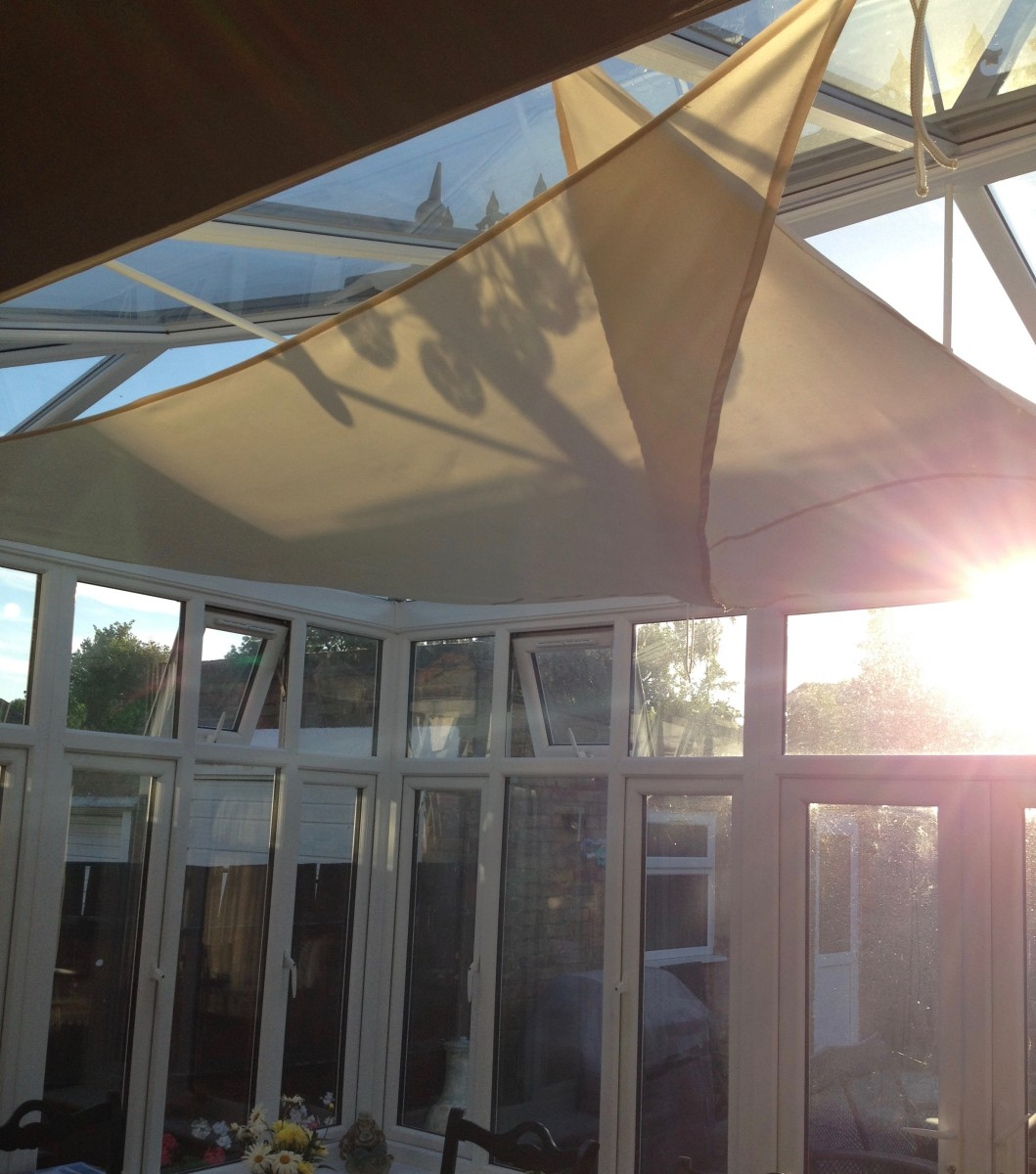 How to create shade in a hot conservatory using shade for Shade sail cost