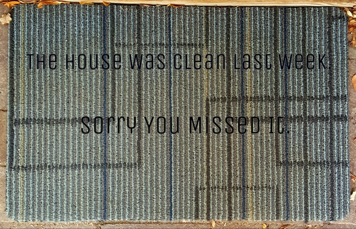 The rug outside of my front door with a funny saying added.
