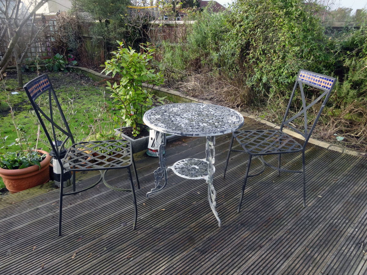 Table and chairs on decking.