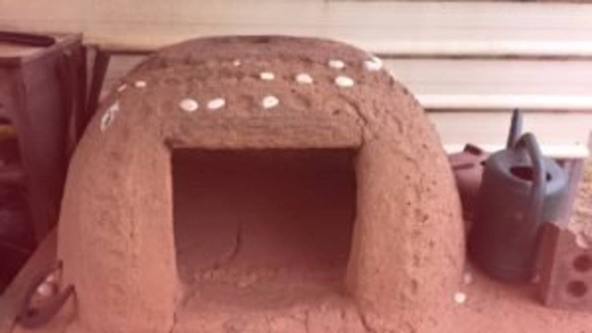 The first cob pizza oven we built for ourselves: showing vent hole at the top, and stones for decoration