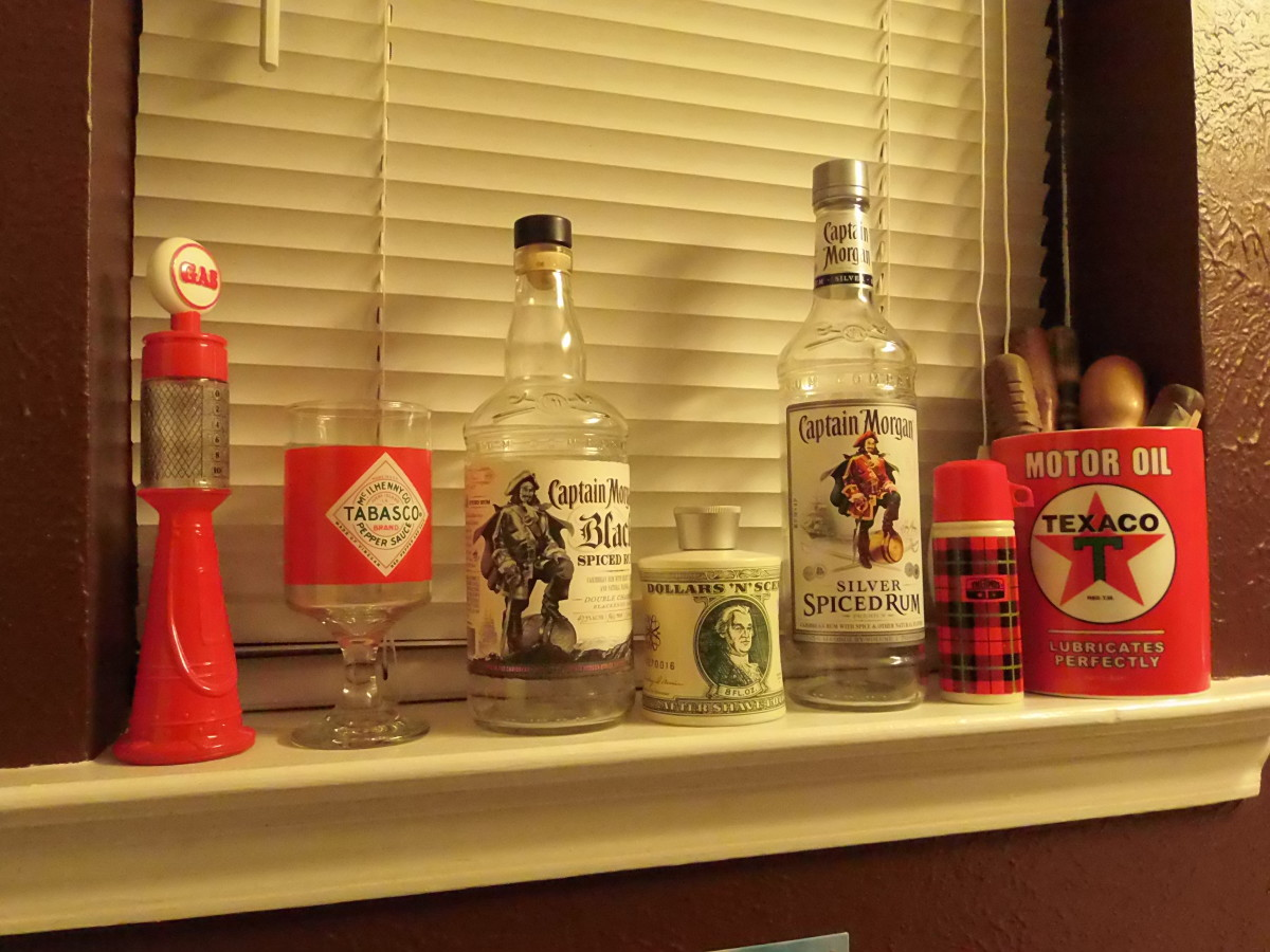 Retro Avon bottles, extra large Texaco mug full of antique screwdrivers, and empty Captain Morgan bottles.