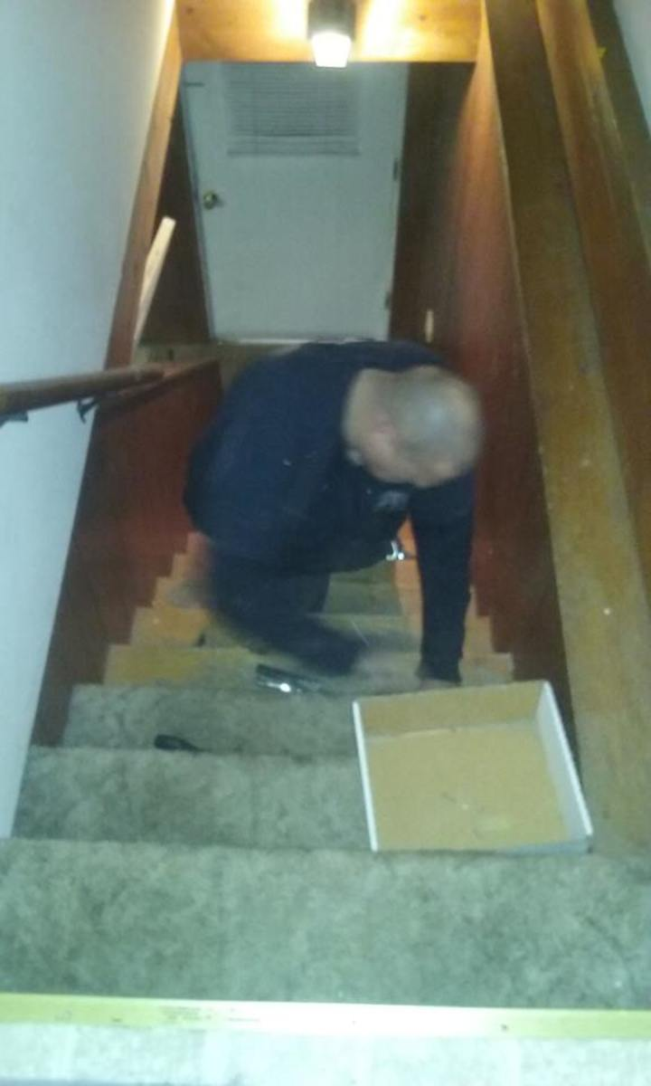 Husband, begrudgingly helping with carpet removal.