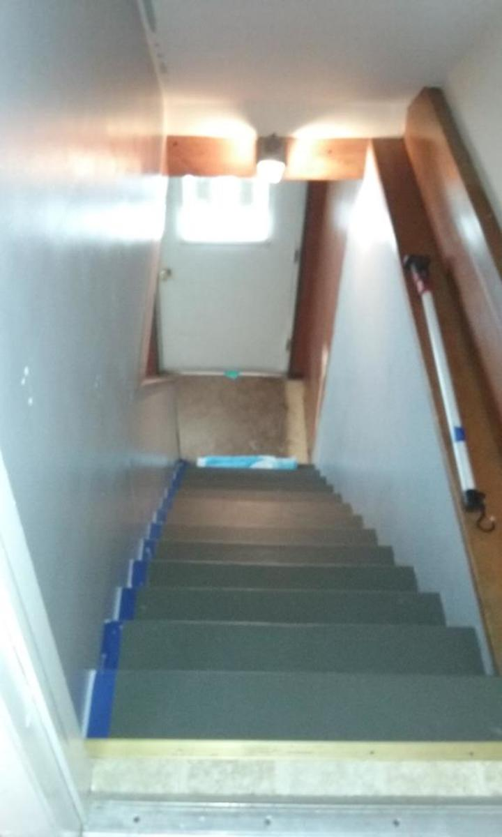 Stairs during wall painting.