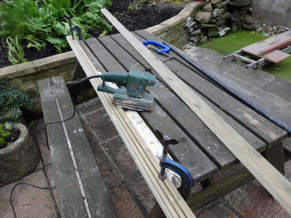 Length of decking cut in half to use as facing for the LED light channel.