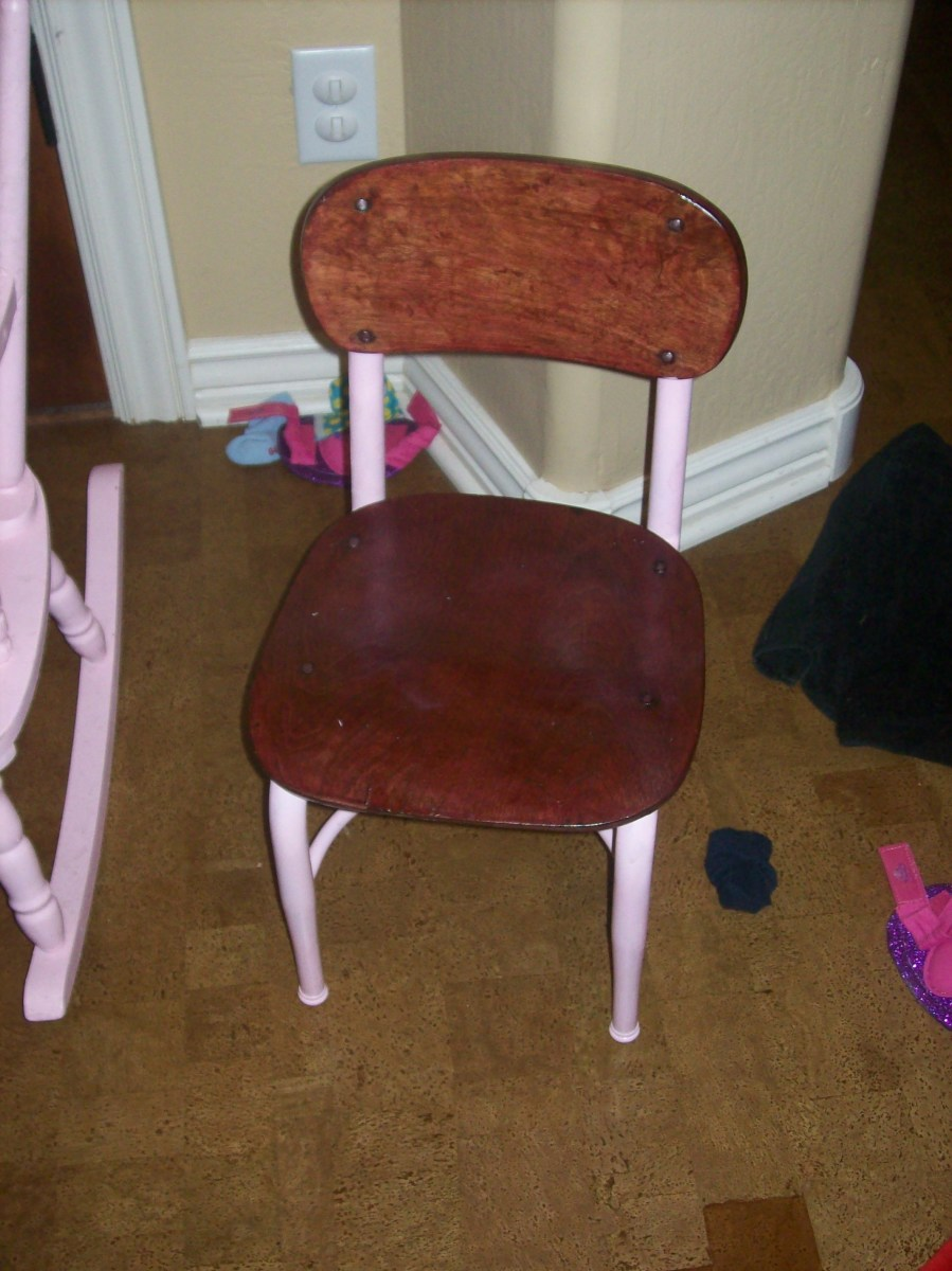 A kindergarten chair stained, varnished, and painted - pink, of course