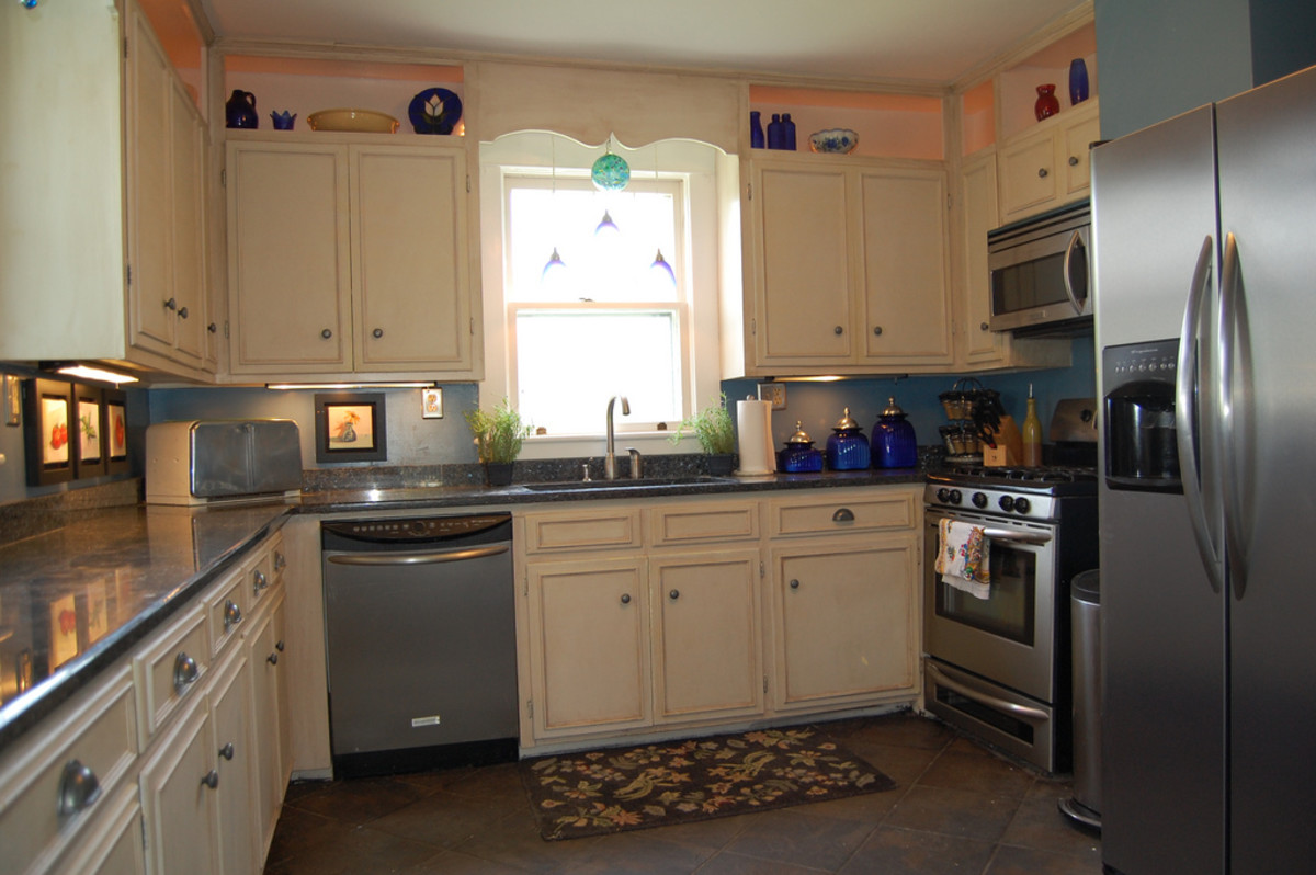How To Clean Greasy Lasani Wood Metal Crystal And Laminate Kitchen Cabinets Dengarden Home And Garden