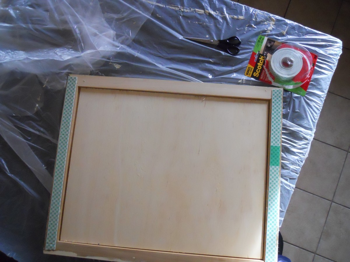 When completely dry  I used wood glue to glue the panel in the frame.  When that dried, I applied mounting tape to the back following package instructions.  I removed the liner paper and pressed the panel to my kitchen island.