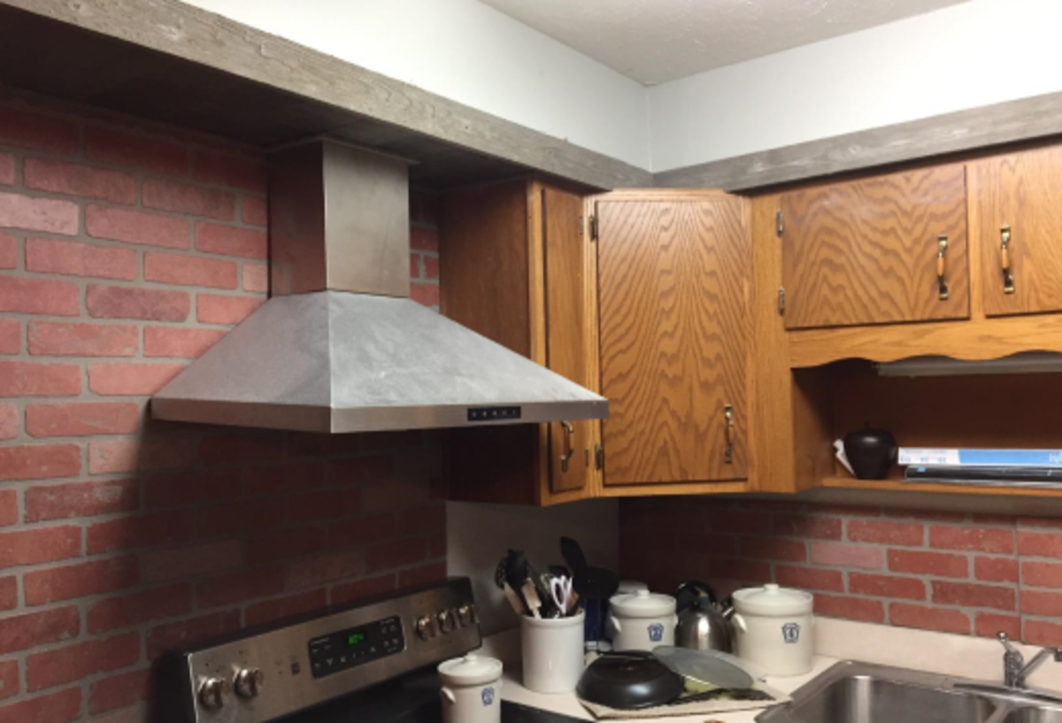 If you're good at metal working, you can easily cut the chimney to make the range hood fit in the available space.