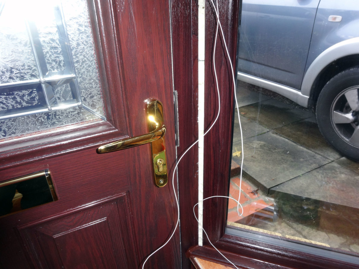 Bell wire next to new door frame ready to feed though predrilled hole to the outside.