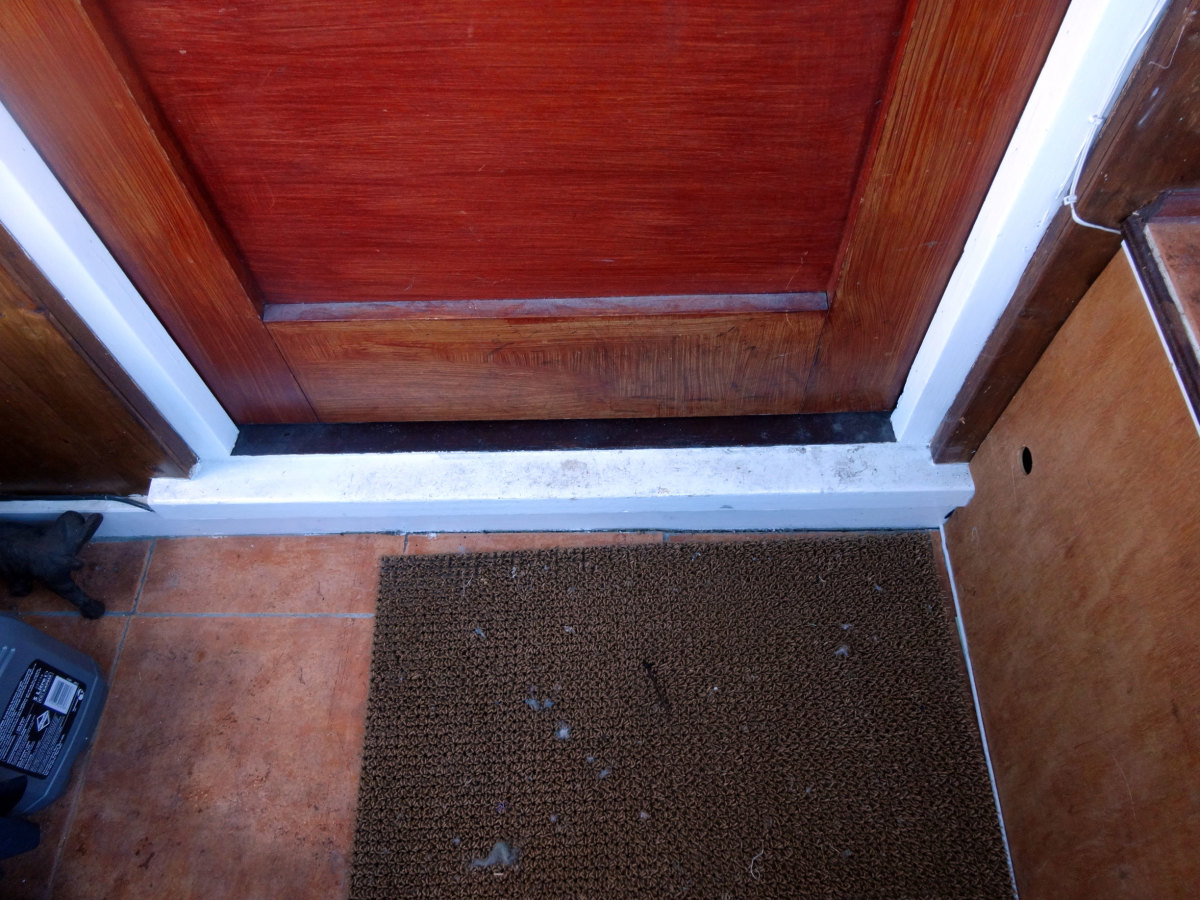 Mahogany door sub-sill painted white, with original door.