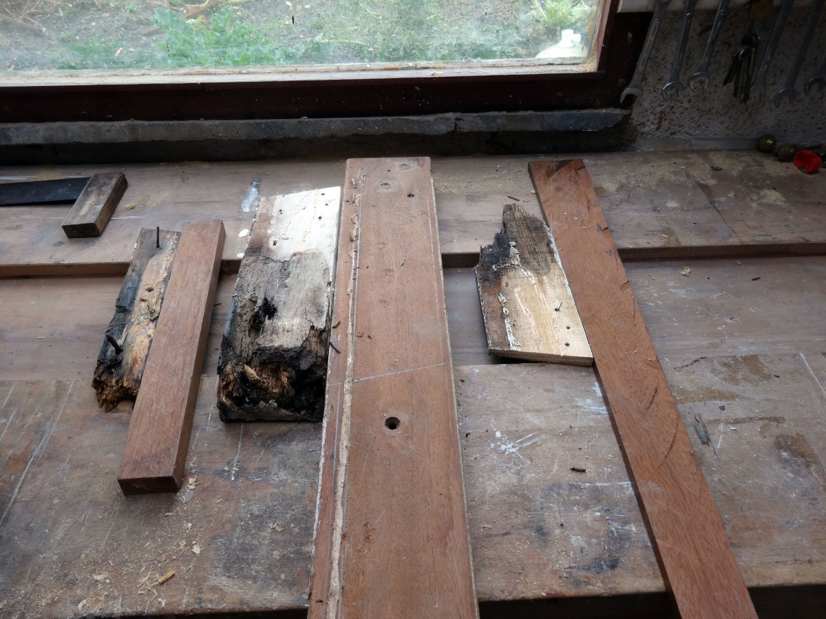 All the rotten pieces laid-out next to pieces of hardwood of the same thickness and depth.