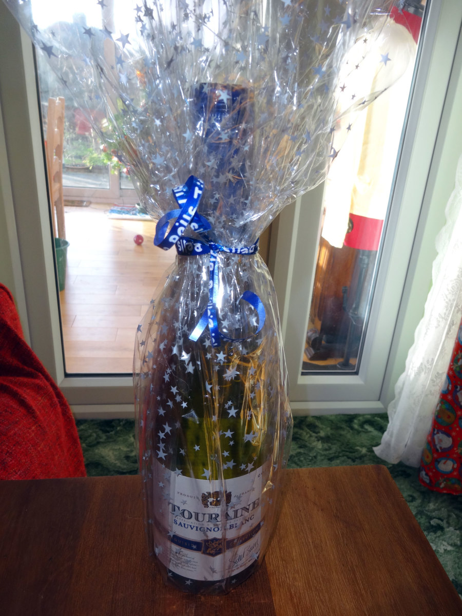 A free bottle of wine given by Caddy Windows, who did our double glazing