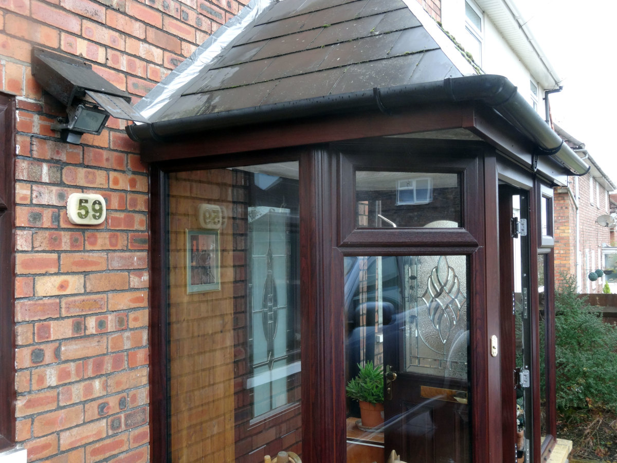 House number fitted to bespoke plague on completion of the porch double glazing.