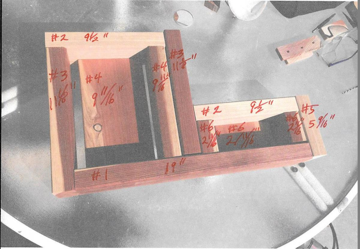 Scanned photo of a trial assembly of a riser with dimensions added in red ink