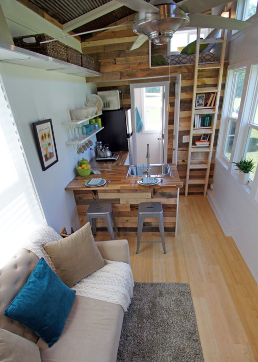 An open concept between the kitchen and living room gives the illusion of more space in this tiny house.