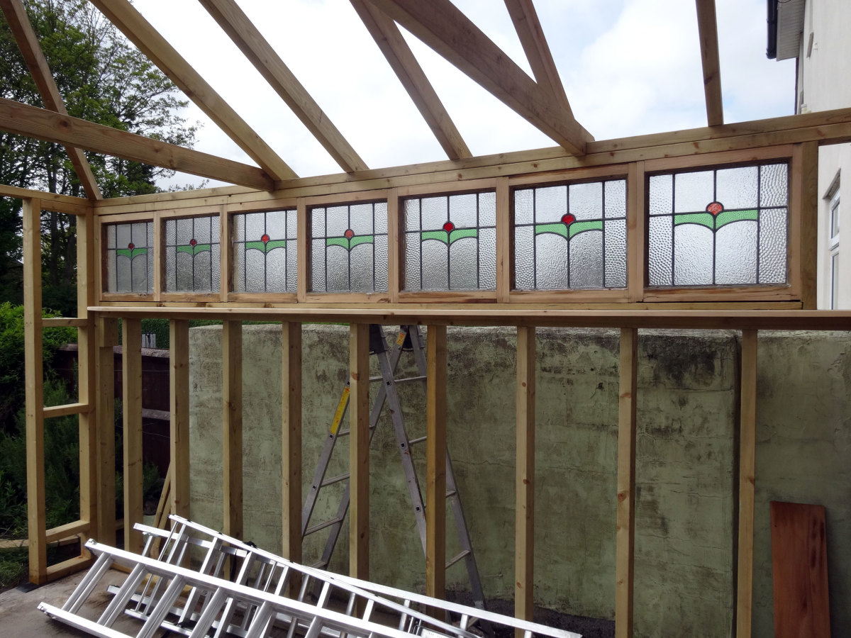 Recycled windows installed, and framed with the offcuts.