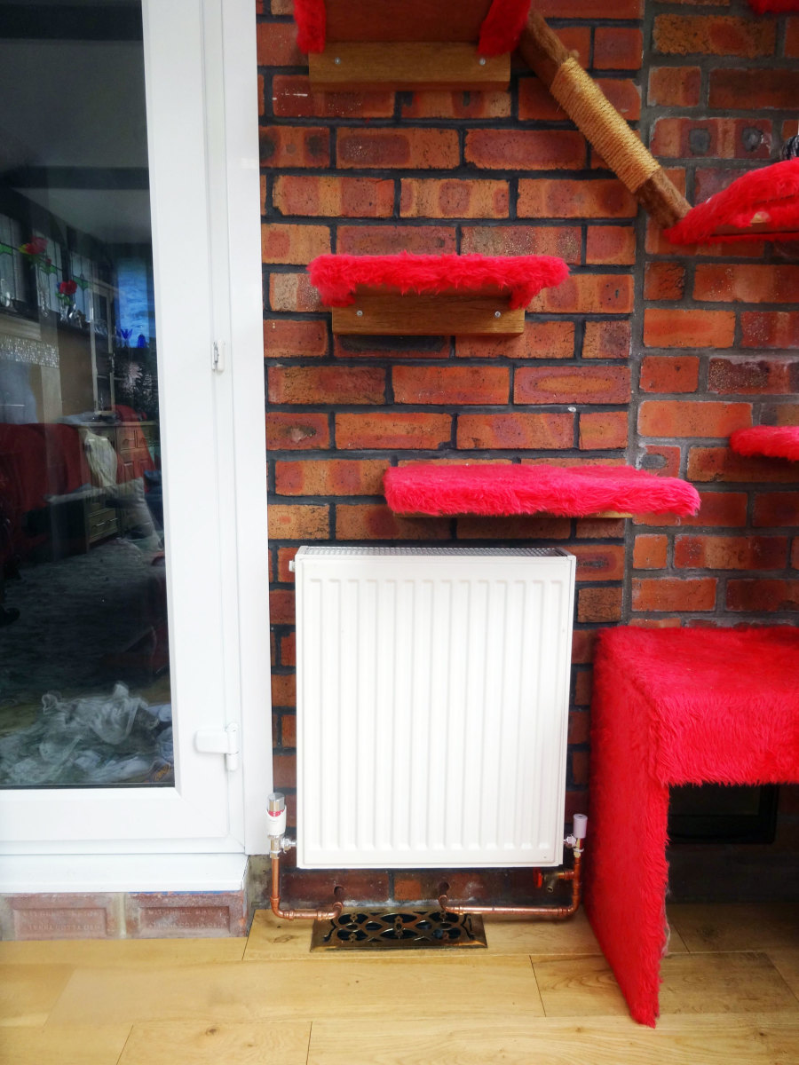 Central heating radiator fitted in conservatory, above air vent.