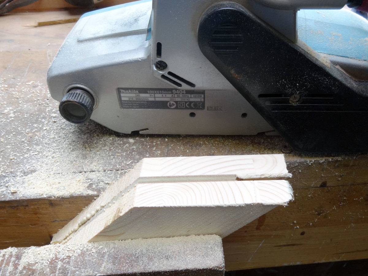 Level off the edges with a belt sander.
