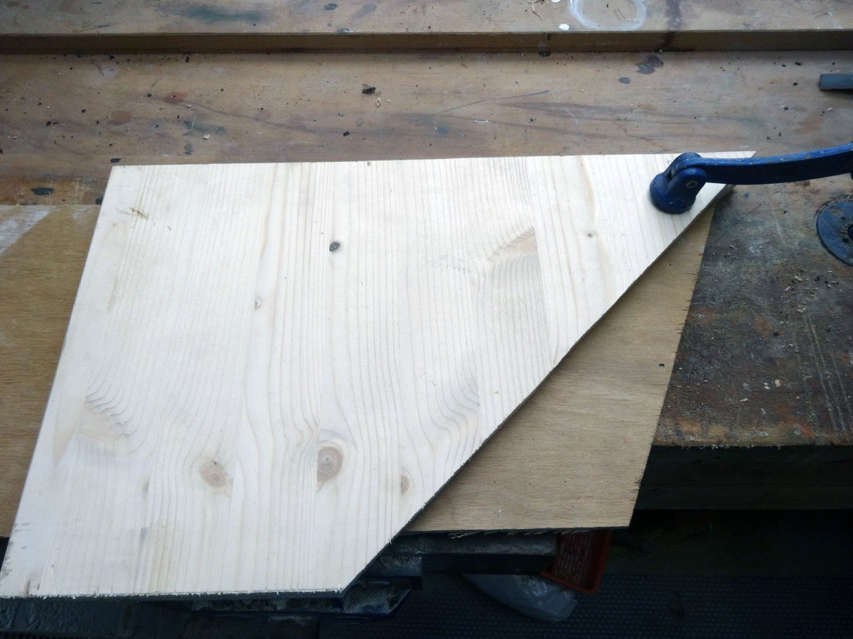 Place the other piece of pinewood over the top to line up with the first piece of pine board.