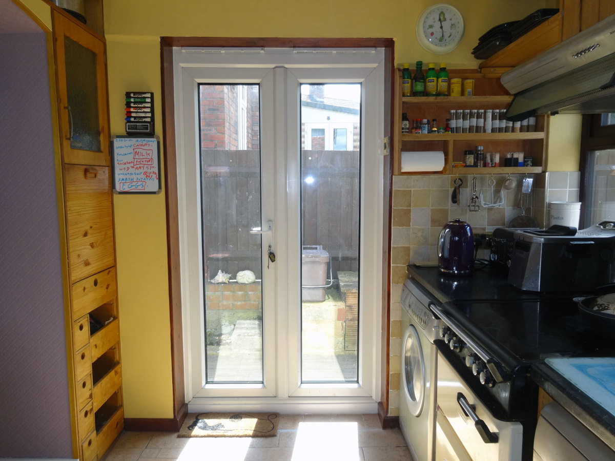 Kitchen Makeover: Removing Brick Doorstep and Modifying Wall by the Backdoor
