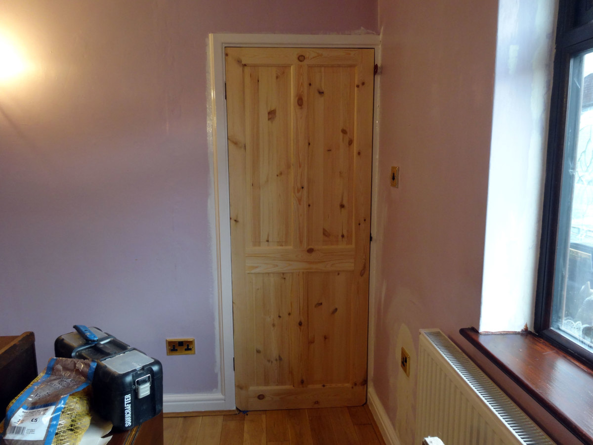 The new solid wood pine door fitted.