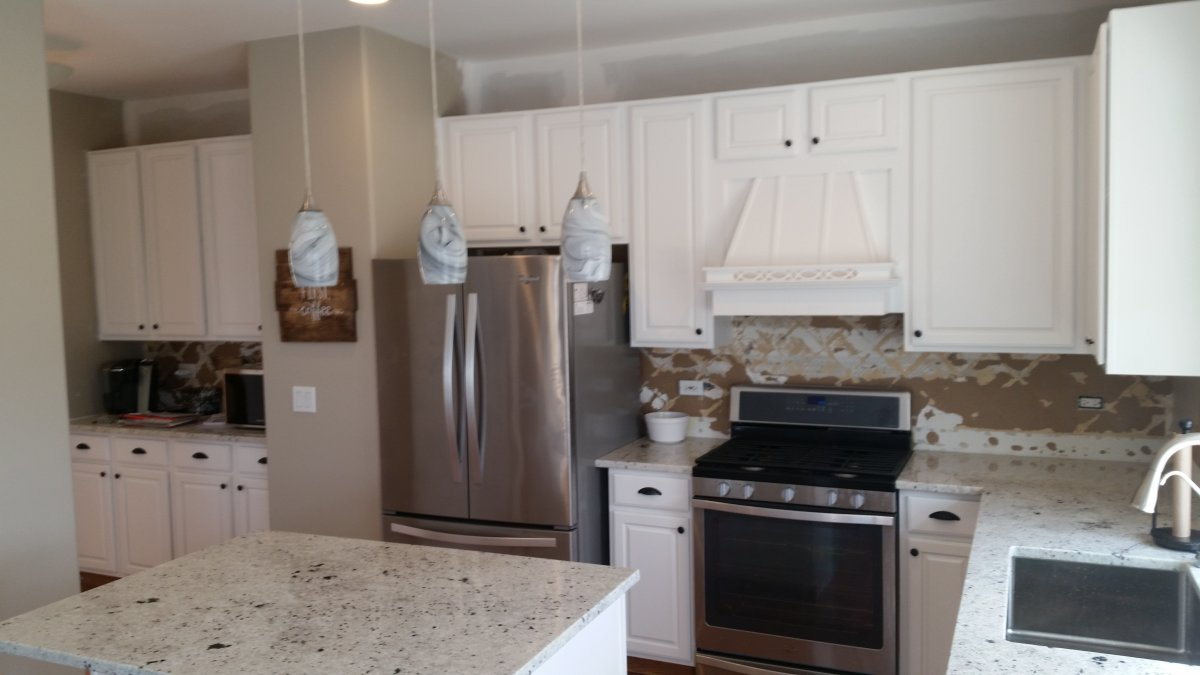 Oak Cabinets Painted White By Advantage Painting Services.