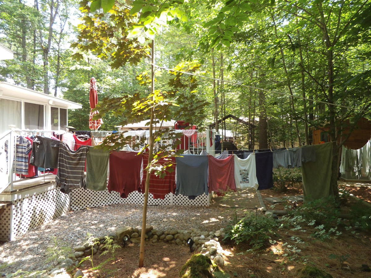 I save 1 or 2 dollars per load by hanging my clothes out. I don't have much of a back yard, so the shirts dry on hangers on the deck railing.