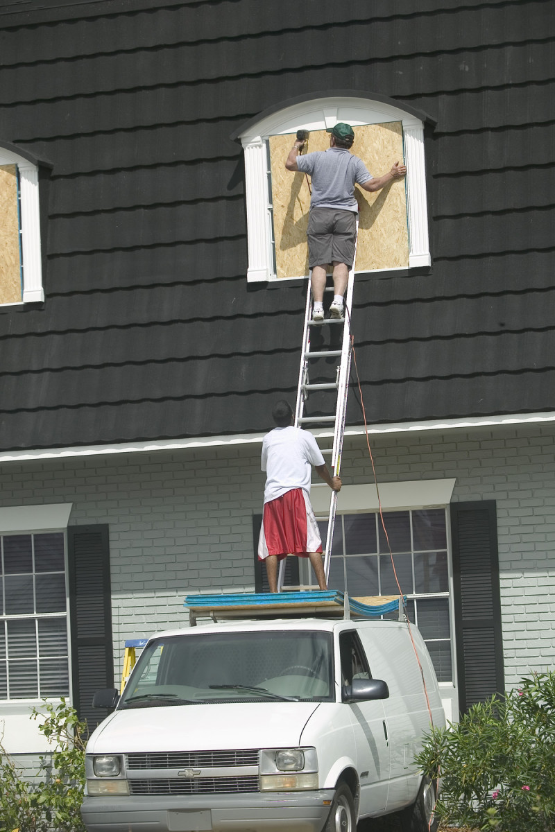 Boarding up the windows before the hurricane arrives