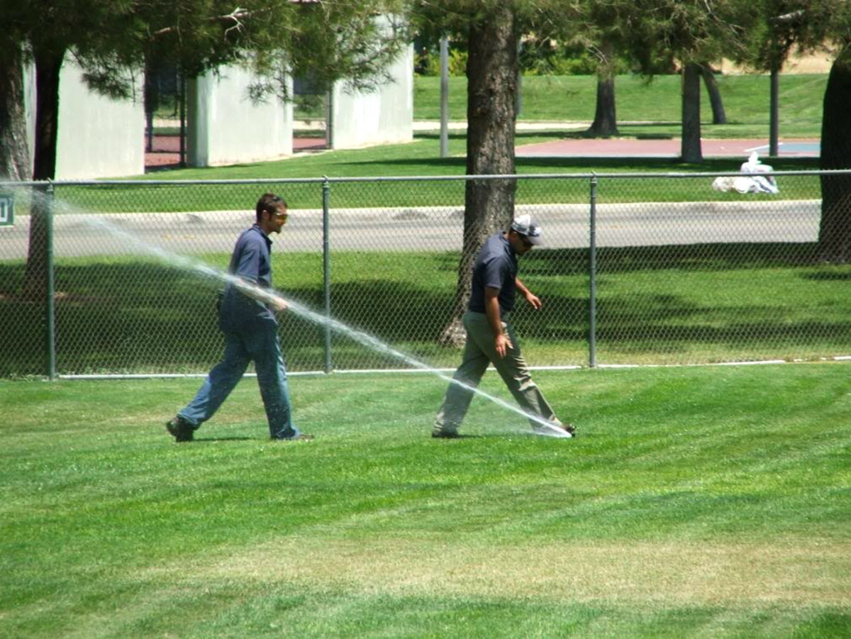 Take a notepad and pen. Have a partner turn on each irrigation station and note which sprinklers are not working. Look for flooded areas and water running into the drain. Make sure the controller is working properly. Make any repairs you need to.