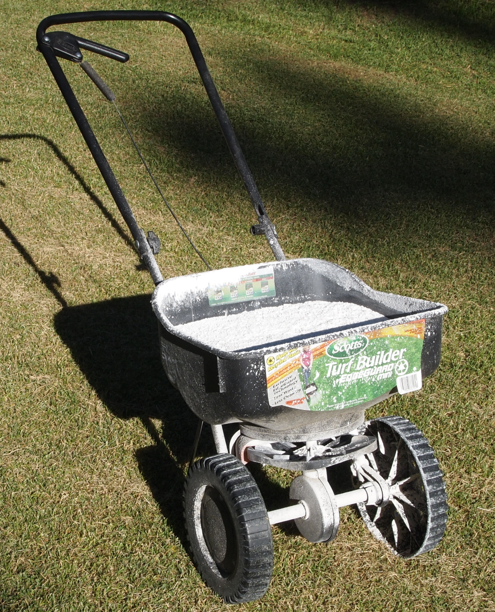 You can use a simple hand-push spreader for fertilizing and also seeding.